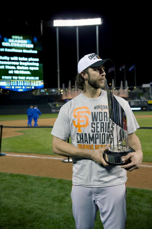 Giants pitcher Madison Bumgarner holds the MVP trophy following the Giants 3-2 victory in Game 7 of baseball's World Series against the Kansas City Royals Wednesday, Oct. 29, 2014, in Kansas City, Mo. (AP Photo/The Sacramento Bee, Jose Luis Villegas) MAGS OUT; LOCAL TELEVISION OUT (KCRA3, KXTV10, KOVR13, KUVS19, KMAZ31, KTXL40); MANDATORY CREDIT
