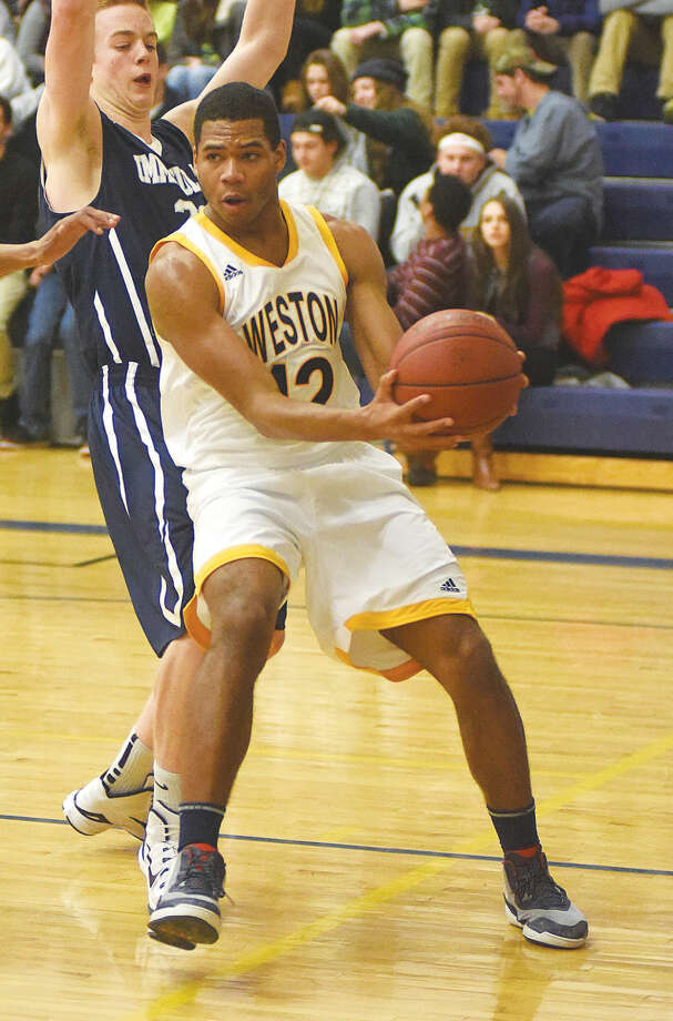 Hour photo/John Nash Nik Parker of Weston will be a key player for the Trojans once again this season.