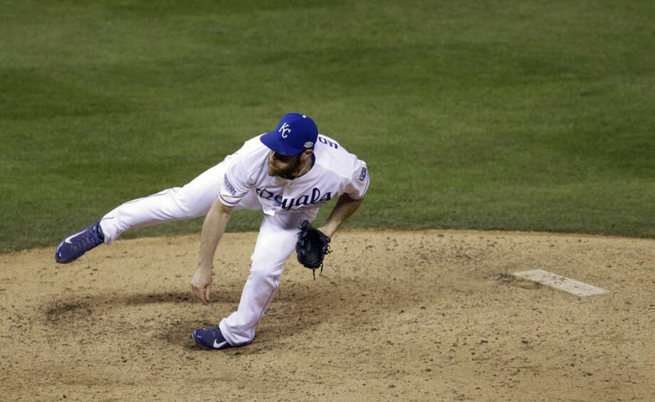 Kansas City Royals pitcher Greg Holland throws during the ninth inning of Game 7 of baseball's World Series against the San Francisco Giants Wednesday, Oct. 29, 2014, in Kansas City, Mo. (AP Photo/Jeff Roberson)