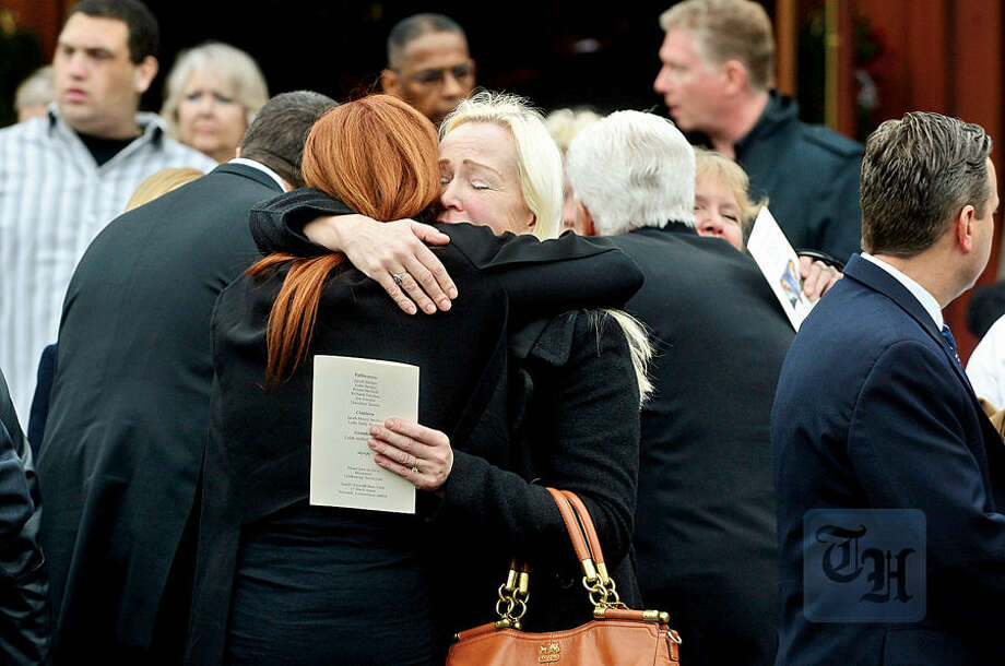 Hour photo / Erik Trautmann Family, friends and dignitaries mourn the loss of State Representative and Soundkeeper Terry Backer following his memorial service at St. Matthew Church in Norwalk Friday morning.