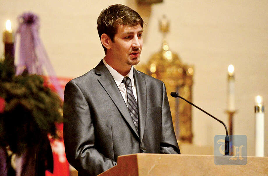 Hour photo / Erik Trautmann Son Jacob Backer delivers one of the eulogies as family, friends and dignitaries mourn the loss of State Representative and Soundkeeper Terry Backer during his memorial service at St. Matthew Church in Norwalk Friday morning.