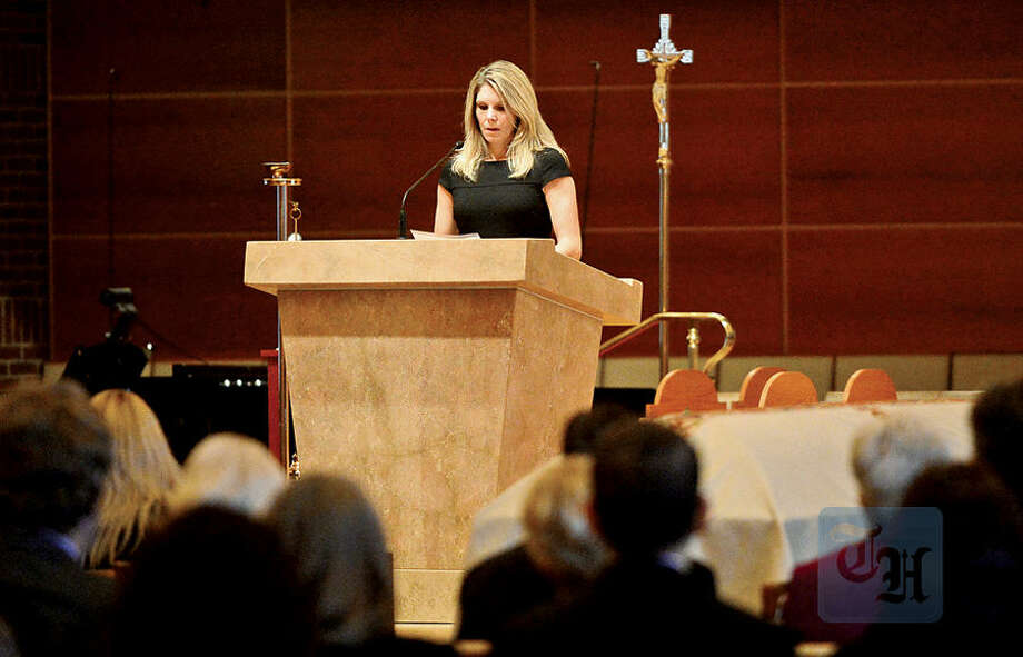 Hour photo / Erik Trautmann Barbara Hayes delivers the first reading as family, friends and dignitaries mourn the loss of State Representative and Soundkeeper Terry Backer during his memorial service at St. Matthew Church in Norwalk Friday morning.