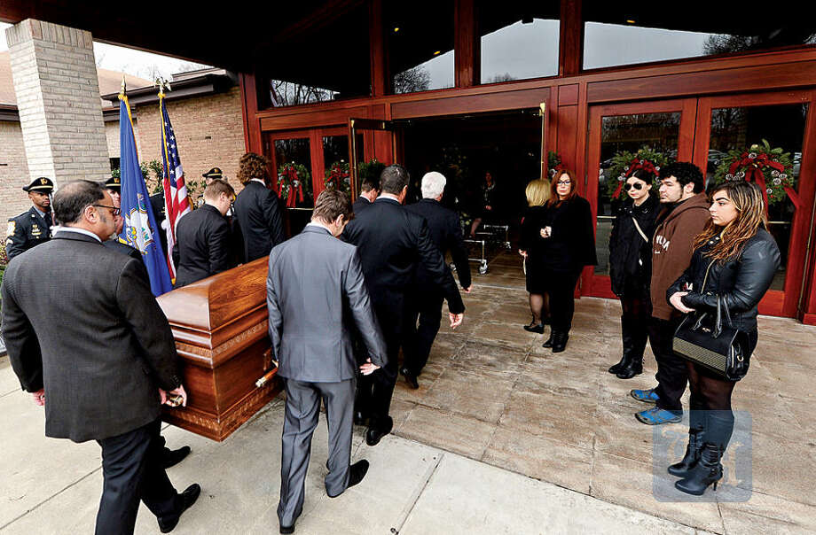 Hour photo / Erik Trautmann Family, friends and dignitaries mourn the loss of State Representative and Soundkeeper Terry Backer during his memorial service at St. Matthew Church in Norwalk Friday morning.