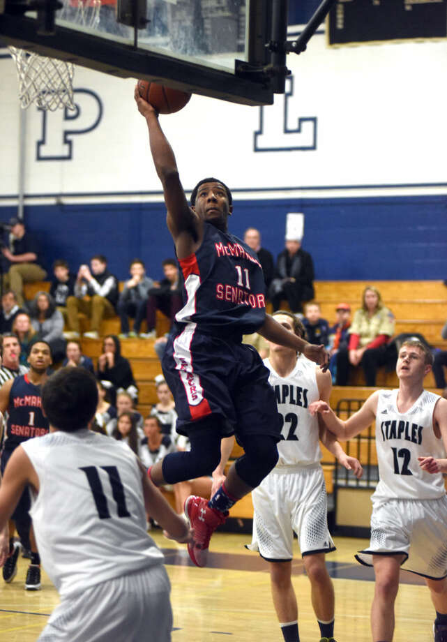 Hour photo/John Nash - McMahon's  Jahmerikah-Green Younger goes up for a lay up against Staples last season. The Staples boys basketball team defeated Brien McMahon 65-54 on Thursday, Jan. 22, 2015.