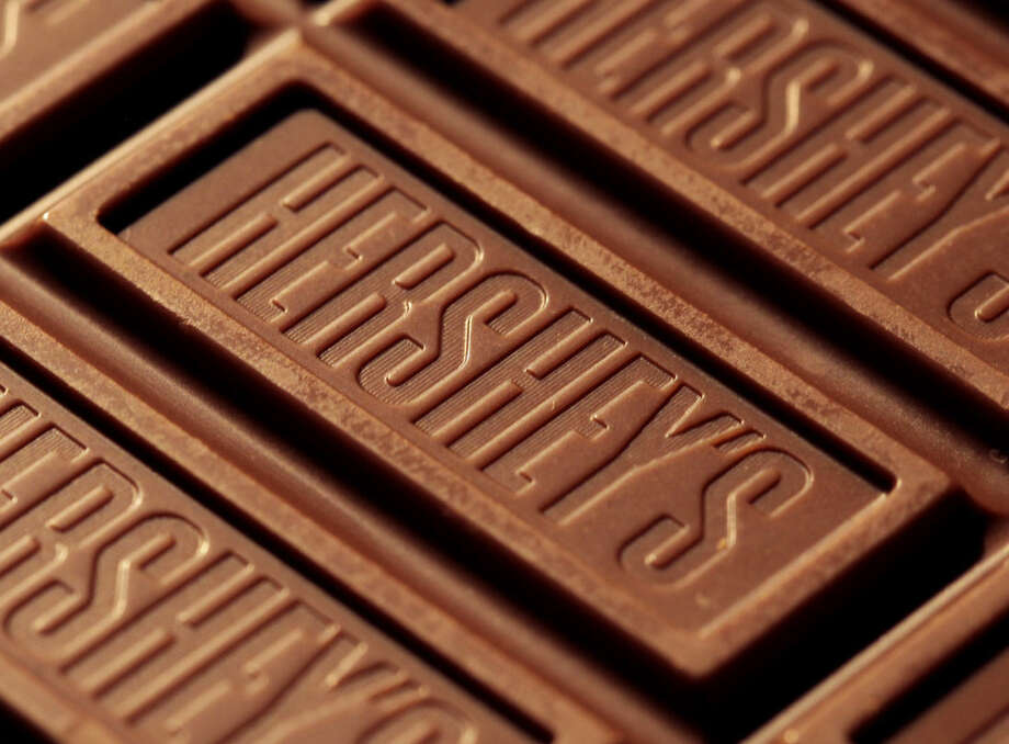 FILE - This July 25, 2011 file photo shows Hershey's chocolate in Overland Park, Kan. The cost of the ingredients in chocolate is rising, and the nation's biggest candy makers have already warned that shoppers are going to see price hikes in 2015. (AP Photo/Charlie Riedel, File)