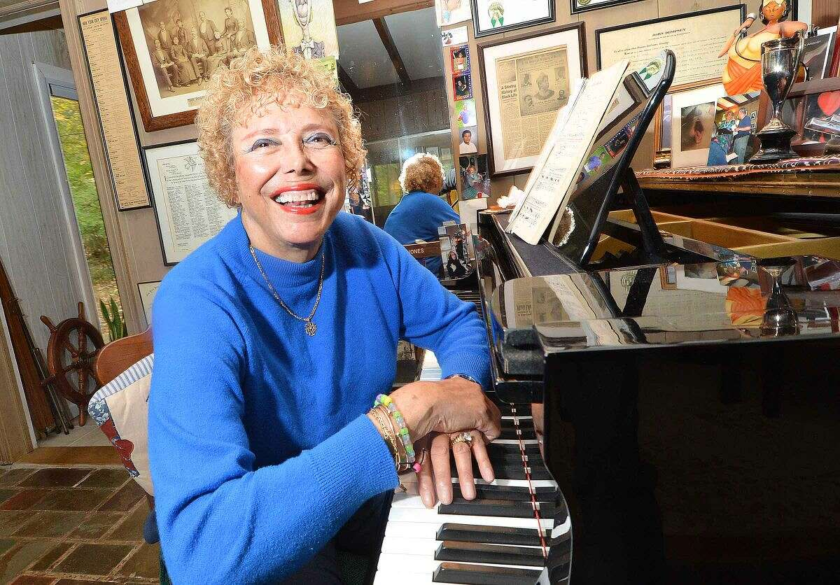 Opera singer Betty Jones talks about her book at her Wilton home.