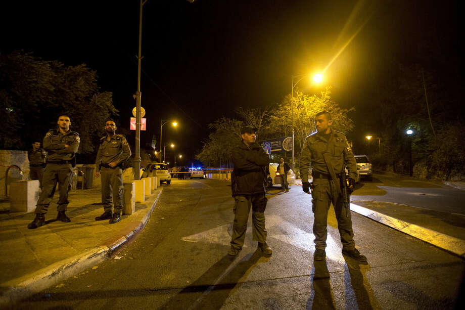 "Israeli police officers stand guard at the scene of a shooting in Jerusalem, Wednesday, Oct. 29, 2014. Israeli police say a man has been shot in Jerusalem in a suspected assassination attempt. Police spokesman Micky Rosenfeld said the man who was shot Wednesday was a ""relatively known figure"" and is in serious condition. Police set up roadblocks and were searching for a suspect who had fled on a motorbike. (AP Photo/Sebastian Scheiner)"