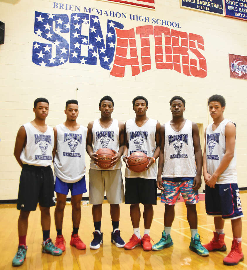 Hour photo/John Nash - Brien McMahon High School senior boys basketball players are, from left to right, Marvin Best, T.J. Burden, David Civil, Jahmerikah Green-Younger, Jared Fields, and Joey Cantey.