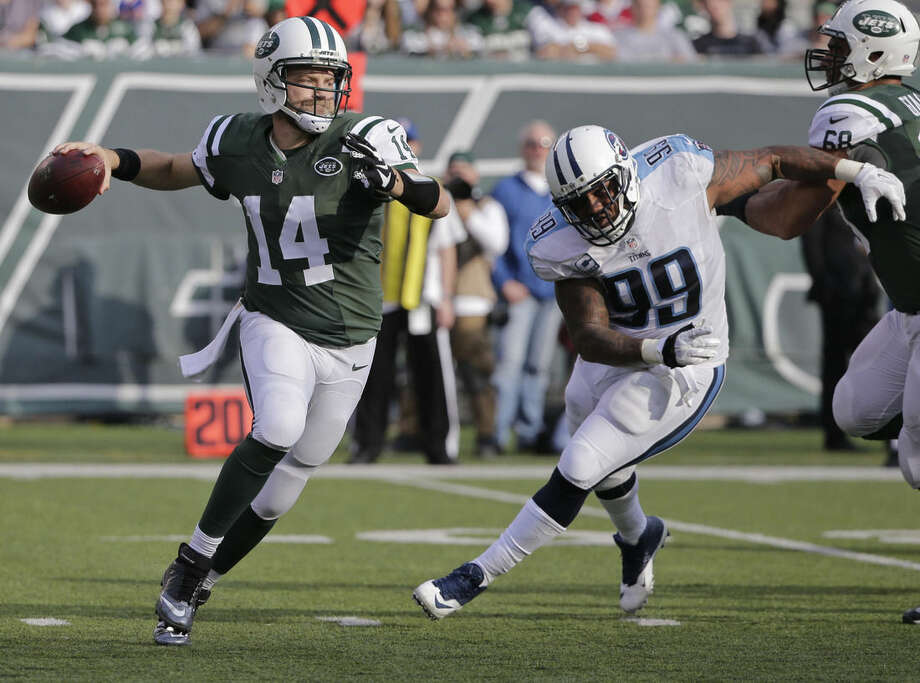 FILE - In this Sunday, Dec. 13, 2015 file photo, New York Jets quarterback Ryan Fitzpatrick (14) throws a pass away from Tennessee Titans' Jurrell Casey (99) during the first half of an NFL football game in East Rutherford, N.J. The New York Jets play the Dallas Cowboys on Saturday, Dec. 19, 2015. (AP Photo/Julie Jacobson, File)