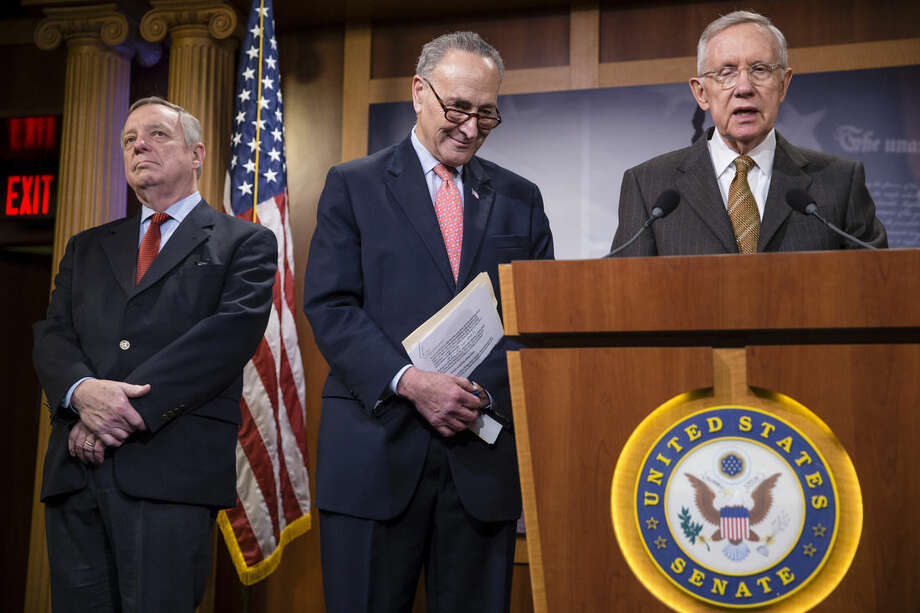 From left, Senate Minority Whip Dick Durbin, D-Ill., Sen. Chuck Schumer, D-N.Y., and Senate Minority Leader Harry Reid, D-Nev., talk to reporters after the Senate gave sweeping approval to a year-end budget package that boosts federal agency spending and awards tax cuts to both families and an array of business interests, at the Capitol in Washington, Friday, Dec. 18, 2015. President Barack Obama will sign the measure, which includes many of the spending increases he fought for all year and is largely free of GOP attempts to block his moves on the environment, financial regulation, and consumer protection. (AP Photo/J. Scott Applewhite)