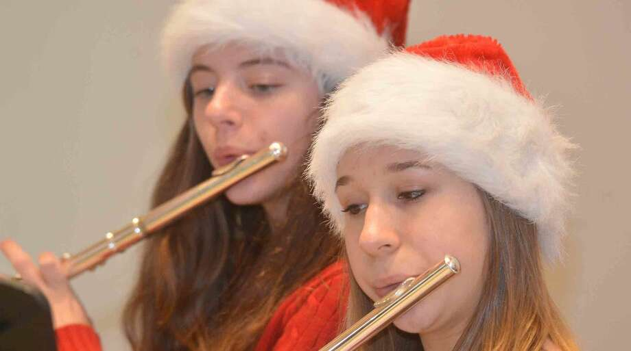 Hour Photo/Alex von Kleydorff Middlebrook School's 8th grade Flute Choir plays some holiday tunes during Ogden House Holiday Luncheon