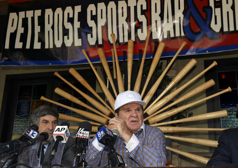 Former baseball player and manager Pete Rose, right, speaks at a news conference, Tuesday, Dec. 15, 2015, in Las Vegas, after Major League Baseball commissioner Rob Manfred announced Monday that he had rejected Rose's plea for reinstatement. Rose agreed to the ban in August 1989 after an investigation found that he had bet on the game while he was a manager for the Cincinnati Reds. At left is lawyer Mark Rosembaum. (AP Photo/Mark J. Terrill)