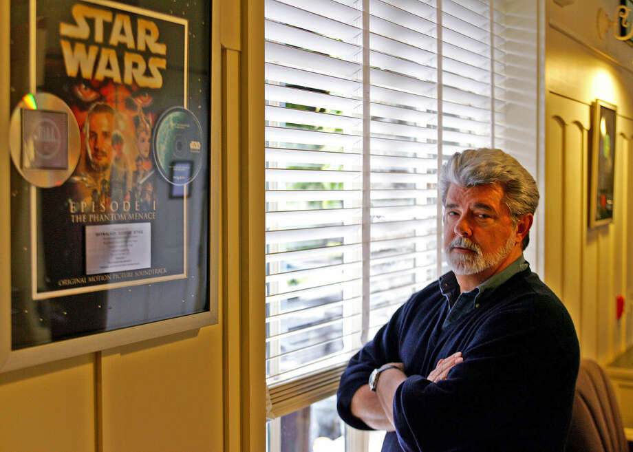 "FILE- In this May 4, 2005 file photo, George Lucas, director of ""Star Wars Episode III: Revenge of the Sith,"" poses at Skywalker Ranch in San Rafael, Calif. The effect ""Star Wars"" has had on movies is as colossal as the Death Star itself and to some, just as fearsome. The new Disney/Lucasfilm release, ""Star Wars: The Force Awakens,"" opens in U.S. theaters on Dec. 18, 2015. (AP Photo/Eric Risberg, File)"