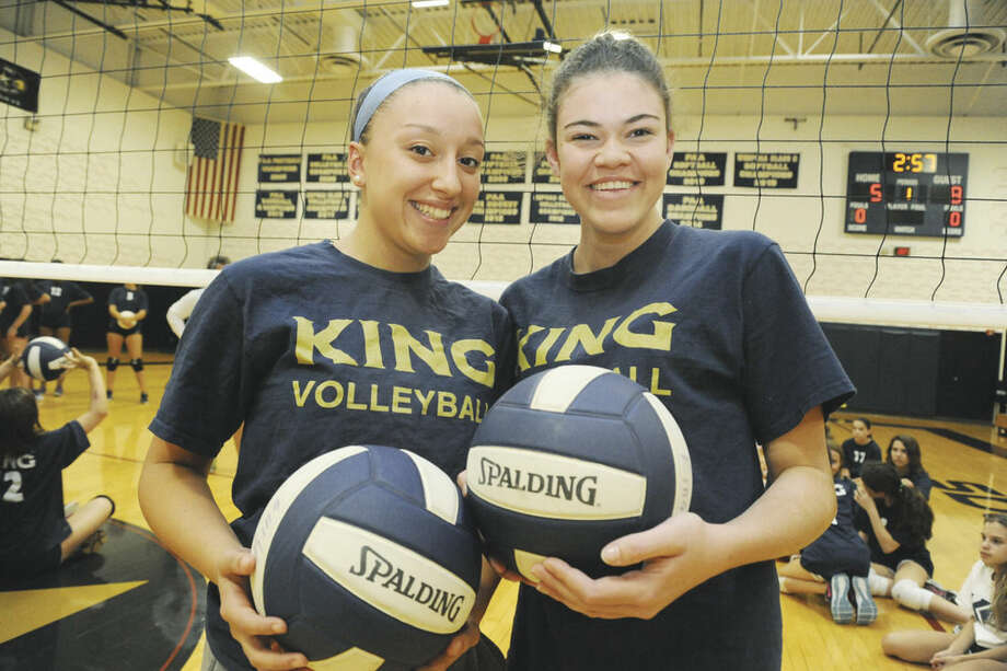 Photo by Matthew VinciIdalis Figueroa, left, and Alex Radassa are the captains of the undefeated King girls volleyball team.