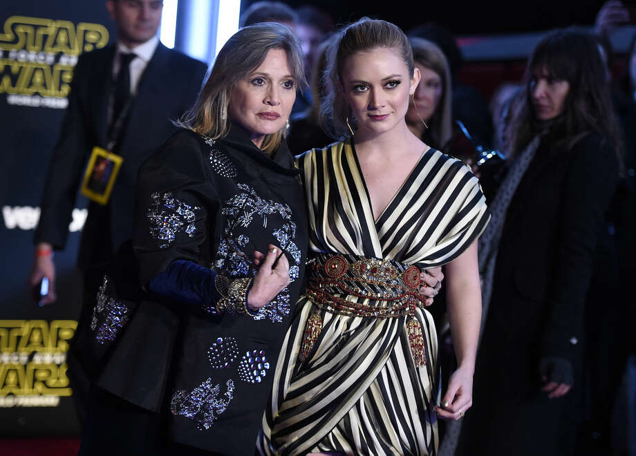 "Carrie Fisher, left, and daughter Billie Lourd arrive at the world premiere of ""Star Wars: The Force Awakens"" at the TCL Chinese Theatre on Monday, Dec. 14, 2015, in Los Angeles. (Photo by Jordan Strauss/Invision/AP)"