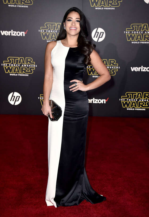 "Gina Rodriguez arrives at the world premiere of ""Star Wars: The Force Awakens"" at the TCL Chinese Theatre on Monday, Dec. 14, 2015, in Los Angeles. (Photo by Jordan Strauss/Invision/AP)"