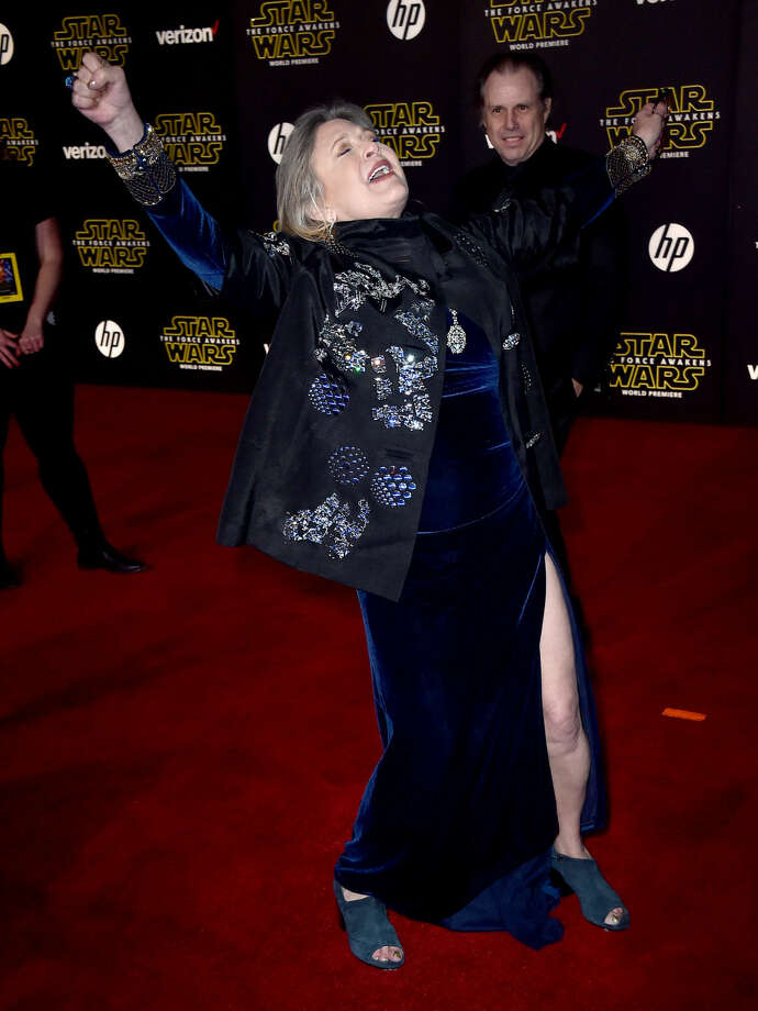 "Carrie Fisher arrives at the world premiere of ""Star Wars: The Force Awakens"" at the TCL Chinese Theatre on Monday, Dec. 14, 2015, in Los Angeles. Fisher plays the role of Leia in the film. (Photo by Jordan Strauss/Invision/AP)"