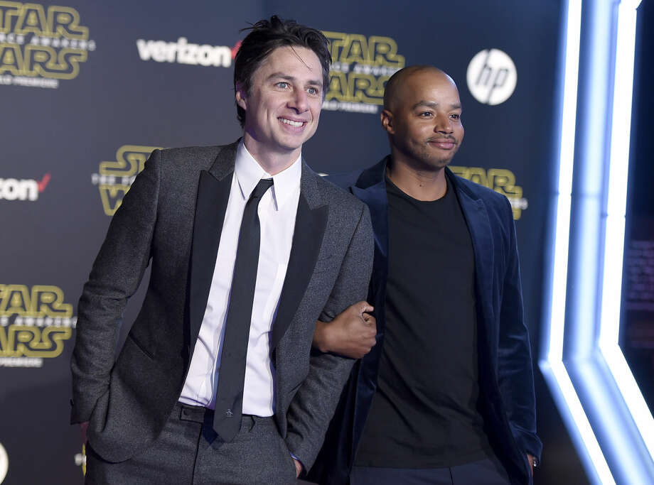 "Zach Braff, left, and Donald Faison arrive at the world premiere of ""Star Wars: The Force Awakens"" at the TCL Chinese Theatre on Monday, Dec. 14, 2015, in Los Angeles. (Photo by Jordan Strauss/Invision/AP)"