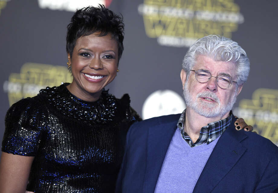"Mellody Hobson, left, and George Lucas arrive at the world premiere of ""Star Wars: The Force Awakens"" at the TCL Chinese Theatre on Monday, Dec. 14, 2015, in Los Angeles. (Photo by Jordan Strauss/Invision/AP)"