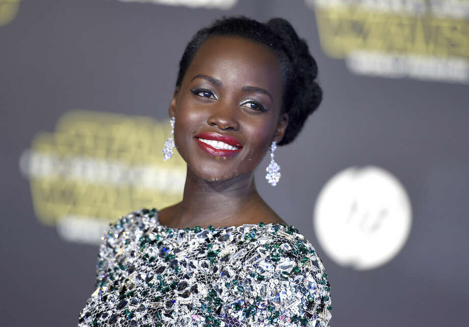 "Lupita Nyong'o arrives at the world premiere of ""Star Wars: The Force Awakens"" at the TCL Chinese Theatre on Monday, Dec. 14, 2015, in Los Angeles. Nyong'o plays the role of Maz Kanata. (Photo by Jordan Strauss/Invision/AP)"