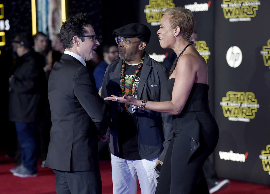 """J.J. Abrams, from left, Spike Lee and Tonya Lewis Lee arrive at the world premiere of """"Star Wars: The Force Awakens"""" at the TCL Chinese Theatre on Monday, Dec. 14, 2015, in Los Angeles. (Photo by Jordan Strauss/Invision/AP)"""