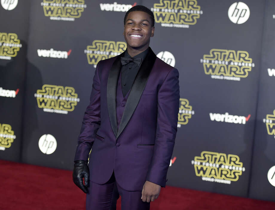 "John Boyega arrives at the world premiere of ""Star Wars: The Force Awakens"" at the TCL Chinese Theatre on Monday, Dec. 14, 2015, in Los Angeles. (Photo by Jordan Strauss/Invision/AP)"