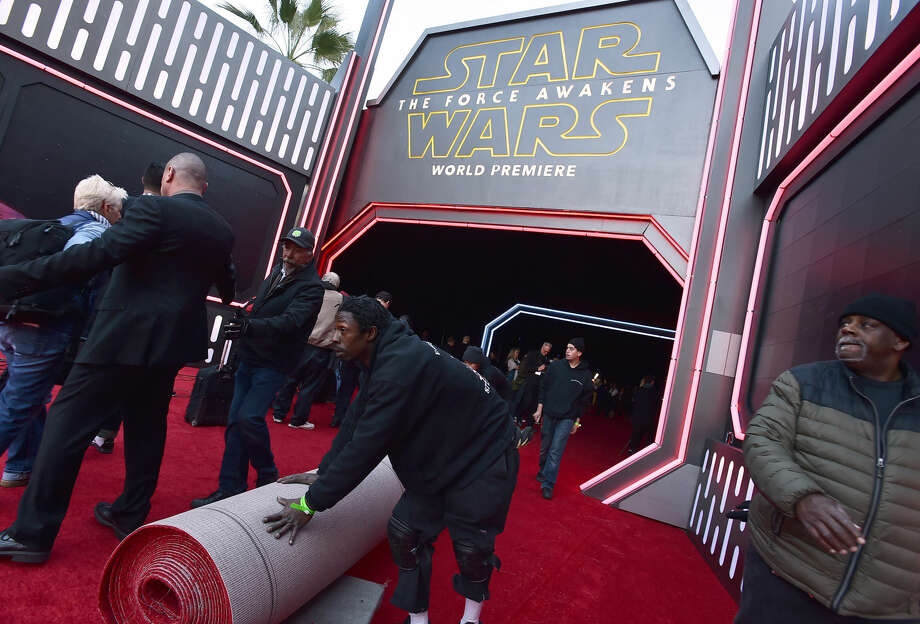 """Staff prepare the red carpet at the world premiere of """"Star Wars: The Force Awakens"""" at the TCL Chinese Theatre on Monday, Dec. 14, 2015, in Los Angeles. (Photo by Jordan Strauss/Invision/AP)"""