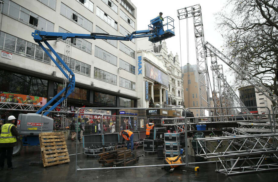 Workmen put up scaffolding for lights and a sound system in London's Leicester Square as preparations are made for the European Premiere of the new Star Wars film 'The Force Awakens' Tuesday, Dec. 15, 2015, the film will have its European gala opening Wednesday. (AP Photo/Alastair Grant)