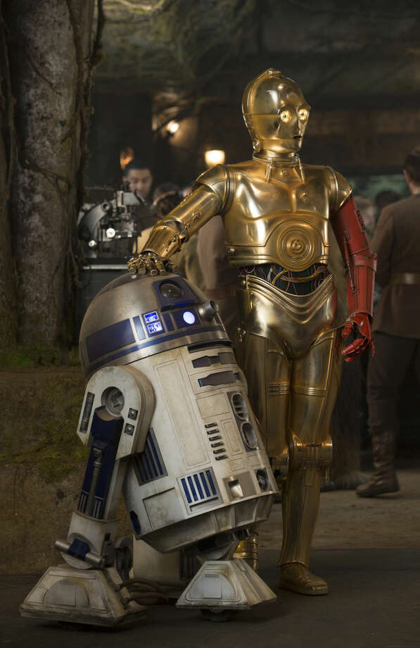 "This photo provided by Disney shows, R2-D2, left, and Anthony Daniels as C-3PO, in a scene from the new film, ""Star Wars: The Force Awakens,"" directed by J.J. Abrams. The movie releases in the U.S. on Dec. 18, 2015. (David James/Disney/Copyright Lucasfilm 2015 via AP)"
