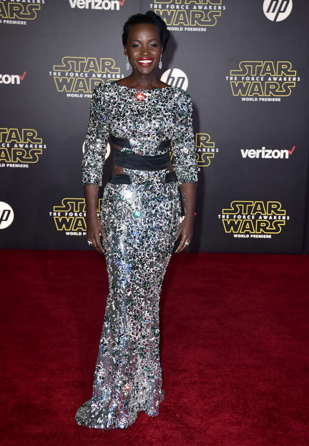 "Lupita Nyong'o arrives at the world premiere of ""Star Wars: The Force Awakens"" at the TCL Chinese Theatre on Monday, Dec. 14, 2015, in Los Angeles. Nyong'o plays the role of Maz Kanata in the film. (Photo by Jordan Strauss/Invision/AP)"