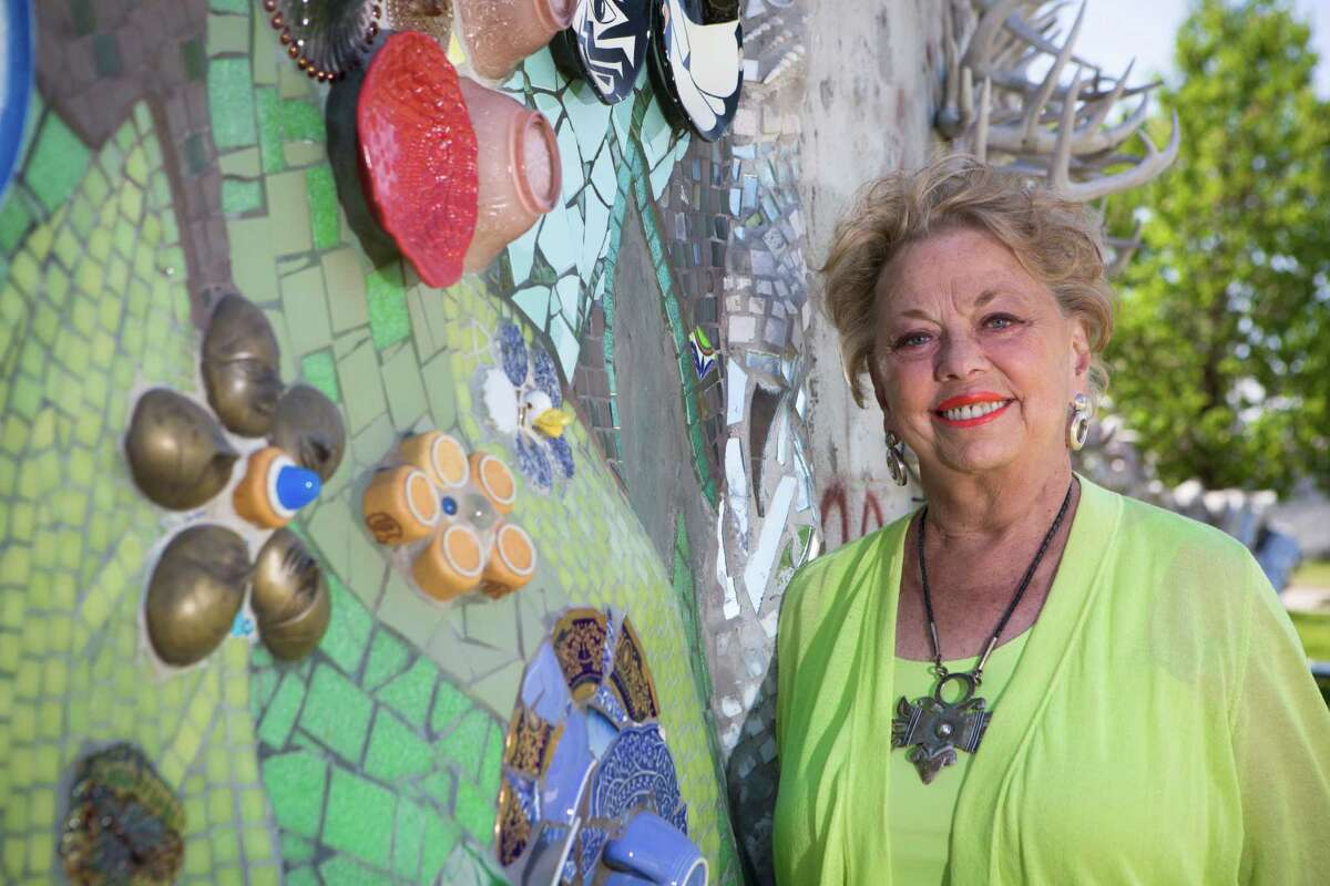 Stephanie Smither, Orange Show Center for Visionary Art Board Member and long-time folk art collector, stands by one of the sections of the Smither Park wall panel. Smither Park is a tribute to her late husband, John Smither, a former board member of the Orange Show Center for Visionary Art. Wednesday, April 30, 2014, in Houston. ( Marie D. De Jesus / Houston Chronicle )
