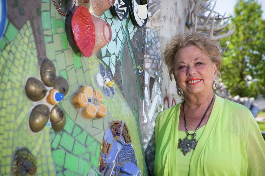 Stephanie Smither, Orange Show Center for Visionary Art Board Member and long-time folk art collector, stands by one of the sections of the Smither Park wall panel. Smither Park is a tribute to her late husband, John Smither, a former board member of the Orange Show Center for Visionary Art. Wednesday, April 30, 2014, in Houston. ( Marie D. De Jesus / Houston Chronicle ) Photo: Marie D. De Jesus, Staff / © 2014 Houston Chronicle