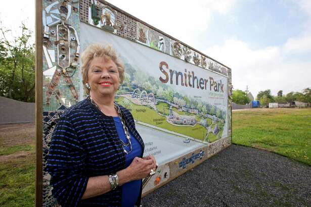 Stephanie Smither stands in front of a sign in the lot that will be Smither Park, Friday, April 1, 2011 near The Orange Show in Houston, Texas (Todd Spoth/For the Chronicle)