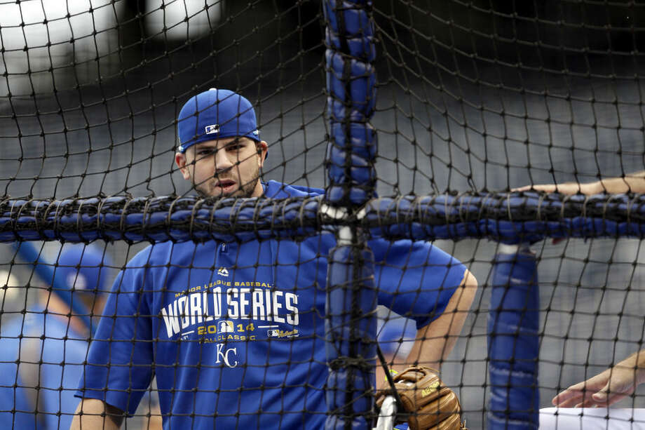 Kansas City Royals' Mike Moustakas prepares to take batting practice during a brief workout Monday, Oct. 27, 2014, in Kansas City, Mo. The Royals and San Francisco Giants are scheduled to play Game 6 of baseball's World Series on Tuesday. (AP Photo/Jeff Roberson)