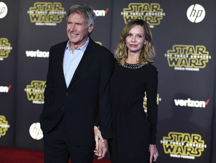 "Harrison Ford, left, and Calista Flockhart arrive at the world premiere of ""Star Wars: The Force Awakens"" at the TCL Chinese Theatre on Monday, Dec. 14, 2015, in Los Angeles. Ford plays the role of Han Solo in the film. (Photo by Jordan Strauss/Invision/AP)"