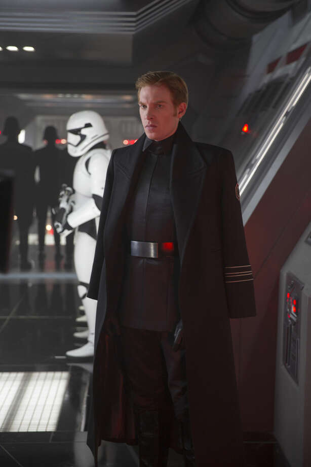 "This photo provided by Disney shows, Domhnall Gleeson as General Hux, in a scene from the new film, ""Star Wars: The Force Awakens,"" directed by J.J. Abrams. The movie releases in the U.S. on Dec. 18, 2015. (David James/Disney/Copyright Lucasfilm 2015 via AP)"