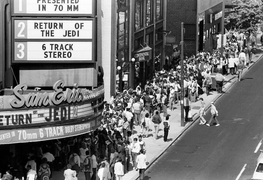 "FILE - In this May 23, 1983 file photo, movie fans line up on Philadelphia's Chestnut Street in advance for the premiere of the movie, ""Star Wars: Episode VI - Return of the Jedi."" The effect ""Star Wars"" has had on movies is as colossal as the Death Star itself and to some, just as fearsome. The new film, ""Star Wars: The Force Awakens,"" opens in U.S. theaters on Dec. 18, 2015. (AP Photo/ George Widman, File)"