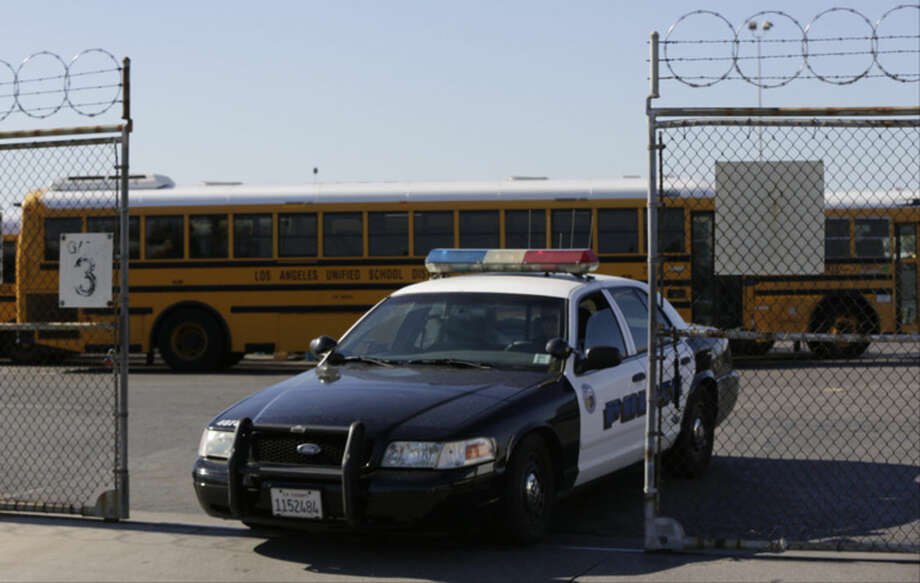 Los Angeles School District police patrols the district's bus garage in Gardena, Calif., Tuesday, Dec. 15, 2015. The nation's two biggest school systems, New York City and Los Angeles, received threats of a large-scale attack Tuesday, and L.A. reacted by shutting down the entire district. New York dismissed the warning as an amateurish hoax and held class as usual. In LA, the threat came in the form of an email to a school board member that raised fears of another attack like the recent deadly shooting in nearby San Bernardino. (AP Photo/Damian Dovarganes)