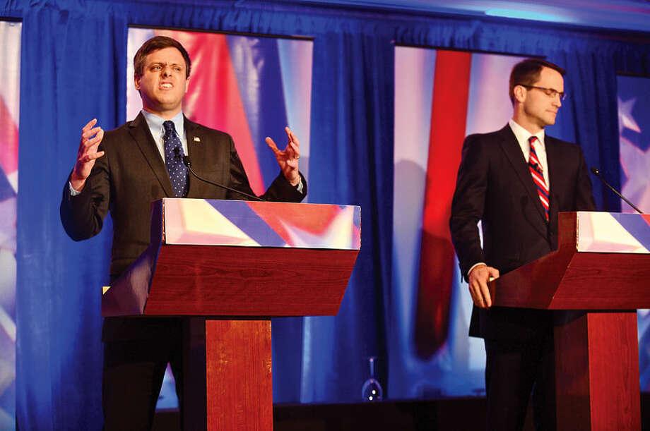 Hour photo / Erik Trautmann GOP challenger Dan Debicella and Connecticut Congressman Jim Himes debate at the Norwalk INN Tuesday afternoon.