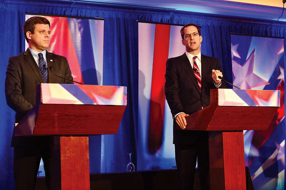 Hour photo / Erik Trautmann Connecticut Congressman Jim Himes, right, and GOP challenger Dan Debicella debate at the Norwalk INN Tuesday afternoon.