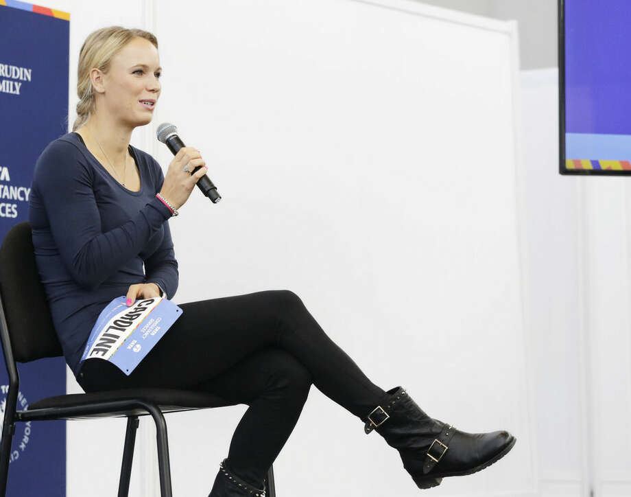 Professional tennis player Caroline Wozniacki talks during a news conference, Wednesday, Oct. 29, 2014 in New York. The Danish tennis star, formerly top-ranked in the world, will run the New York City Marathon, Sunday, Nov. 2 to raise funds for the New York Road Runners Team for Kids charity, which promotes youth running. (AP Photo/Mark Lennihan)