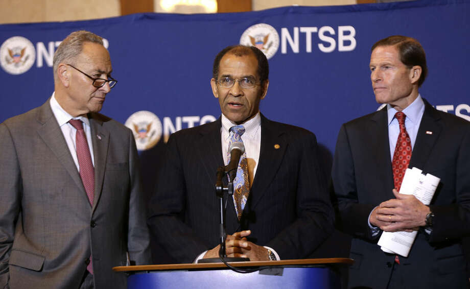 Christopher Hart, acting chairman of the National Transportation Safety Board, center, speaks while surrounded by senators Chuck Schumer (D-NY), left, and Richard Blumenthal (D-CT) during a news conference in New York, Tuesday, Oct. 28, 2014. A sleep-deprived engineer nodded off at the controls of a commuter train just before taking a 30 mph curve at 82 mph, causing a derailment last year that killed four people and injured more than 70, federal regulators said Tuesday. William Rockefeller's sleepiness was due to a combination of an undiagnosed disorder, sleep apnea and a drastic shift in his work schedule, the National Transportation Board said. (AP Photo/Seth Wenig)