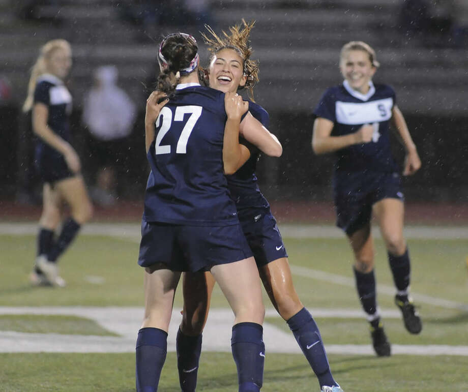 Hour photo/John NashStaples' Lauren Garcia embraces tammate Charlotte Rossi (27) after scoring the game-tying goal in the 76th minute of Wednesday's FCIAC Girls Soccer Championship game at Testa Field in Norwalk. The game against Fairfield Warde finished in a 1-1 tie leaving the Wreckers and the Mustangs as co-champs. It was the first league title for both teams.
