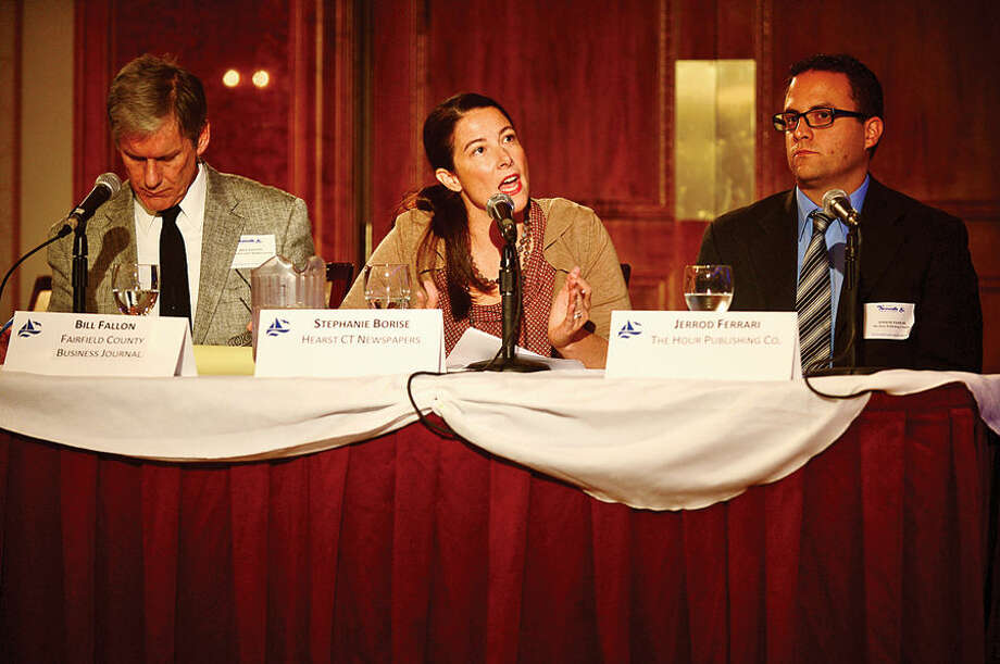 Hour photo / Erik Trautmann Stephanie Borise of Hearst Newspapers asks questions from the panel of Connecticut Congressman Jim Himes and GOP challenger Dan Debicella as they debate at the Norwalk INN Tuesday afternoon.