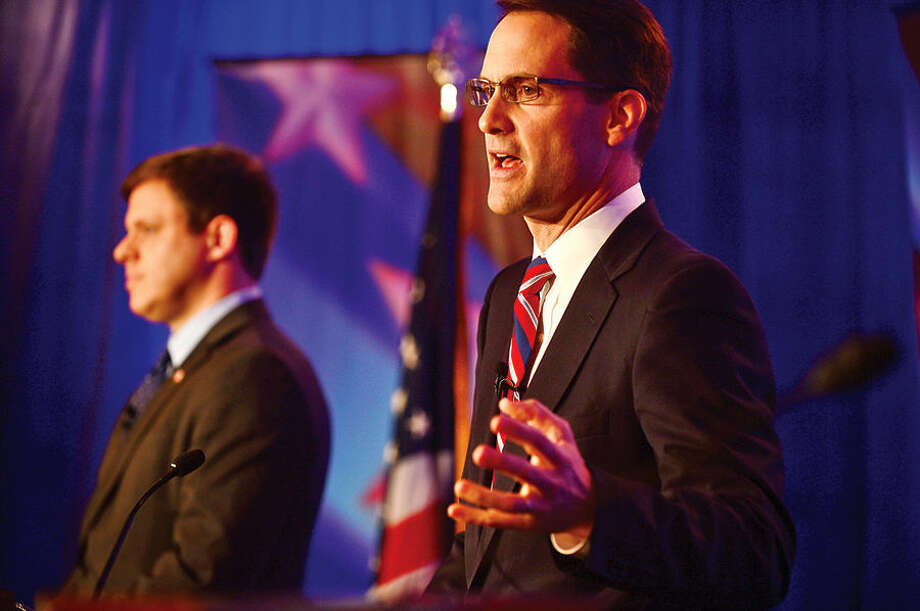 Hour photo / Erik Trautmann Connecticut Congressman Jim Himes and GOP challenger Dan Debicella debate at the Norwalk INN Tuesday afternoon.