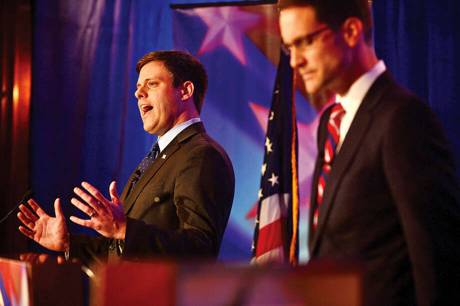 Hour photo / Erik Trautmann GOP challenger Dan Debicella and Connecticut Congressman Jim Himes debate at the Norwalk INN Tuesday afternoon.