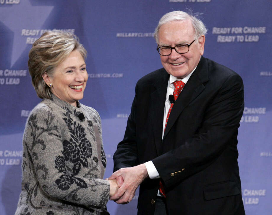 FILE - In this Dec. 11, 2007, file photo, billionaire investor Warren Buffett helps Democratic presidential candidate, then-Sen. Hillary Clinton, D-N.Y., raise campaign funds in San Francisco. When Buffett joins a rally Wednesday, Dec. 16, 2015, with Clinton, a question humming in the background will be whether Buffett, one of the world's premier investors, will throw more of his fortune behind her candidacy than he's been comfortable spending in politics in the past. (AP Photo/Paul Sakuma, File)
