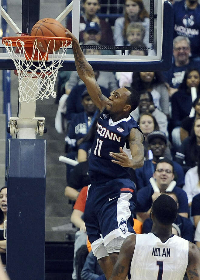 In this Oct. 17, 2014 photo, Connecticut's Ryan Boatright dunks the ball at the men's and women's NCAA basketball teams' First Night event in Storrs, Conn. UConn will host Bryant to open the 2014-15 season on Friday, Nov. 14. (AP Photo/Jessica Hill)