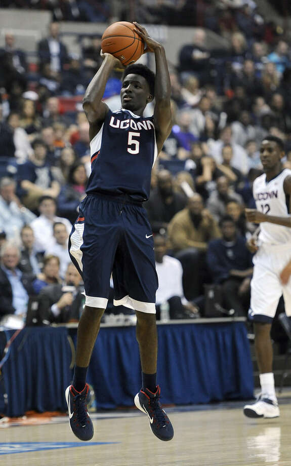 In this Oct. 17, 2014 photo, Connecticut's Daniel Hamilton shoots at the men's and women's NCAA basketball teams' First Night event in Storrs, Conn. UConn will host Bryant to open the 2014-15 season on Friday, Nov. 14. (AP Photo/Jessica Hill)