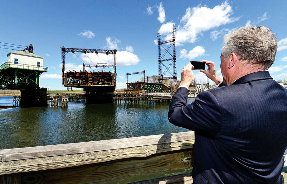 Hour photo / Erik Trautmann Local officials including Norwalk Mayor Harry Rilling witness the opening of the Walk Bridge during a press conference at the Maritime Aquarium Tuesday afternoon.